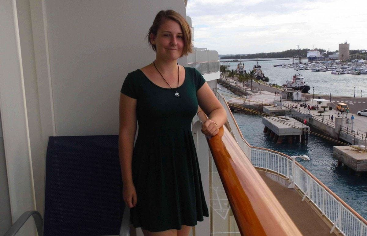 Norwegian Breakaway Dinner Dress Code Girl on Balcony in Green Dress