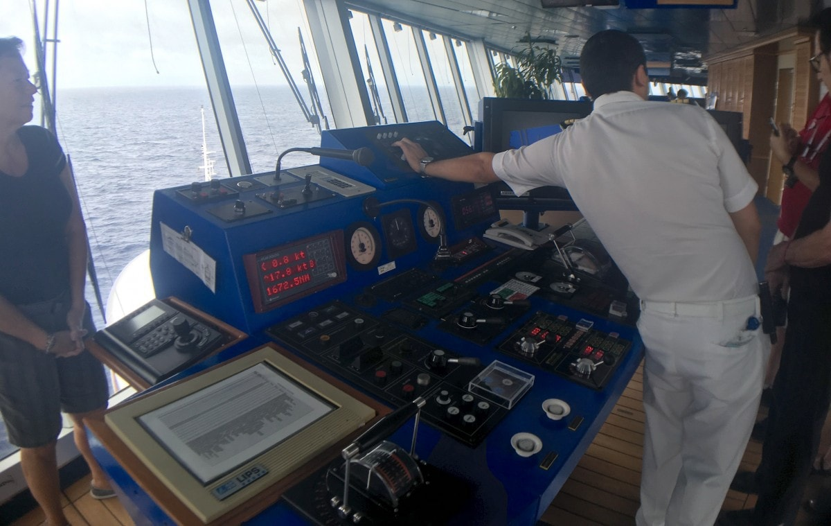 captain and officers giving a tour of the bridge on a cruise ship