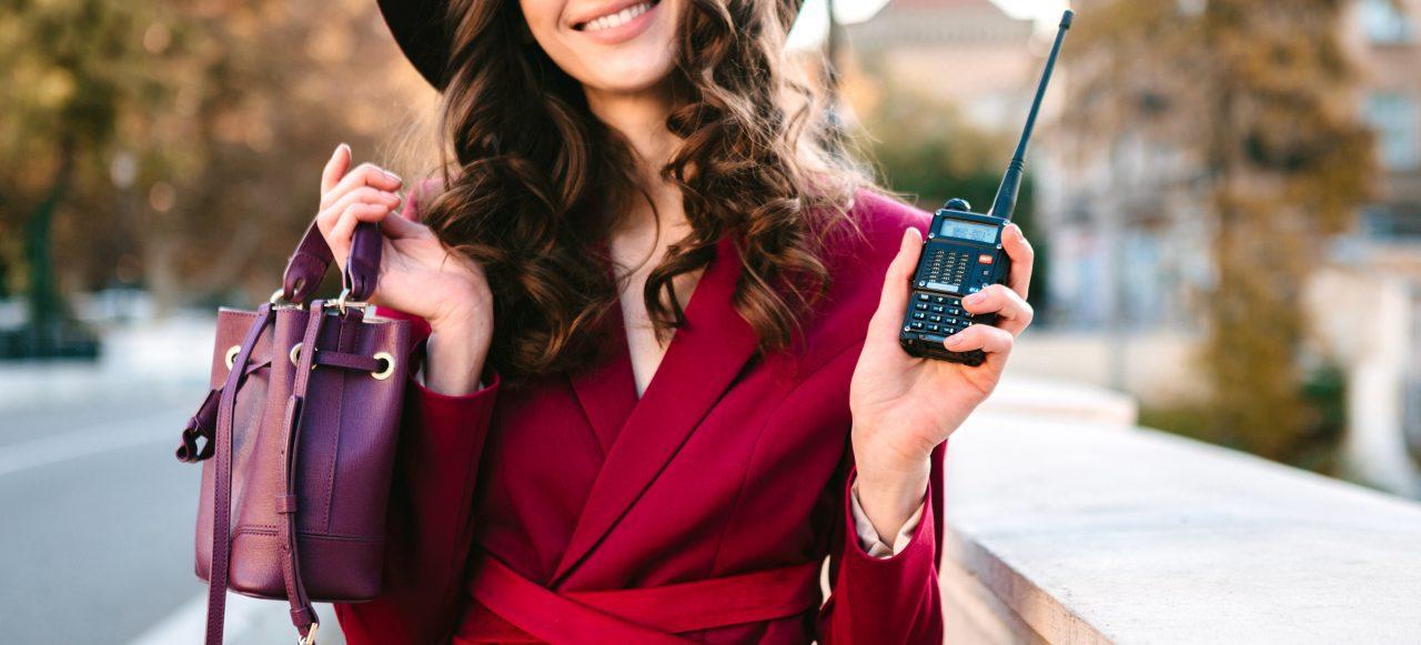women holding a walkie talkie