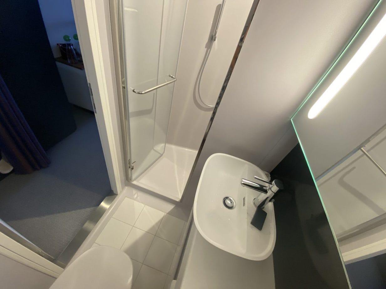 virgin voyages scarlet lady bathroom shower sink and toilet