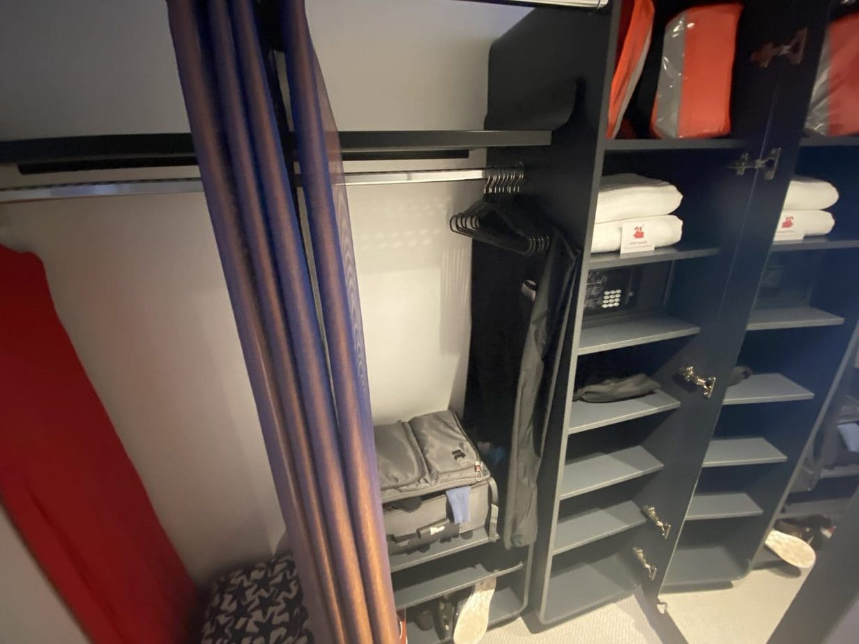 virgin voyages scarlet lady closet storage shelves hanging space and life jackets