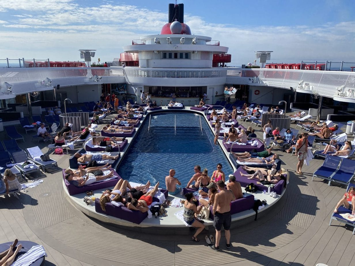 virgin voyages scarlet lady main swimming pool top deck seating